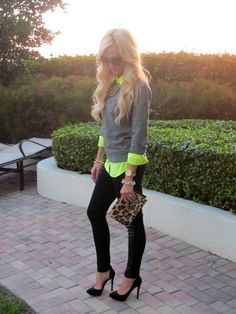 Plain grey sweater and different shoes and purse and no necklace