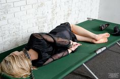 Woman lied down after an all night party agreed to have her hands cuffed behind back.
