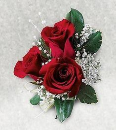Radiant red roses and white baby's breath are joined in this traditional corsage. An engaging gift to celebrate a distinctive occasion. x Your purchase includes a complimentary personalized gift message. Boutonnieres, Prom Corsage And Boutonniere, Corsage Wedding, Wedding Bouquets, Red Rose Boutonniere, Corsage Formal, Wedding Buttonholes, Wedding Boutonniere, Red Corsages