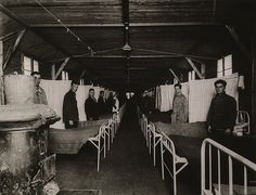 An influenza ward at the U. S. Army Base Hospital in Langres, France during the Spanish Flu epidemic of 1918-19. The second, more deadly wave of the epidemic which often produced pneumonia, emerged in the summer of 1918.