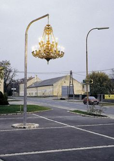 Artist Werner Reiterer creates street art by hanging a chandelier from a light post Street Art, Street Style, Street Chic, Instalation Art, Urban Intervention, Urbane Kunst, Art Plastique, Public Art, Architecture