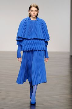Autumn Winter 2013 collection by Jaimee McKenna. Knitted from lambswool, the fabric were felted to create a more rigid material that could be creased into tessellating pleats in various styles. The blue colour used for the entire collection was inspired by an ultramarine shade first mixed by post-war French artist Yves Klein.