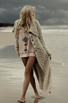 A great beach look for early mornings, late evenings, and generally cool days. A big bulky long cardigan over a swimsuit and coverup
