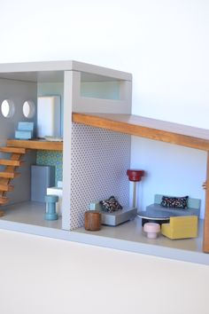 Wooden dollhouse #woodentoys #macarenabilbao #dollhouse