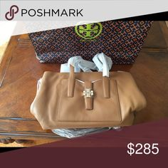 Toryburch purse new Brand new camel color Tory Burch!! It could be yours it is negotiable and today you can get 10% off Tory Burch Bags Shoulder Bags