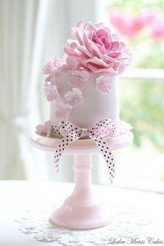 Adorable pink and white single layer wedding cake with polka dot ribbon wedding weddingcake cake pink romantic