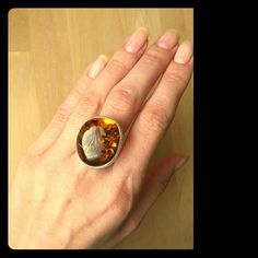 Cognac amber ring Beautiful cognac amber, natural from Baltic sea/Poland. Amber ring- sterling silver, weight- 10.7 grams. Ring is adjustable.New and handmanufactured Great as an original gift :) Feel free t contact me if you have any questions Thanks Jewelry Rings