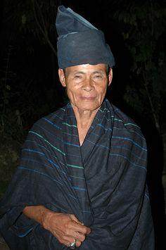 Man of Kajang. A man from Kajang, known as Black Konjo wearing man attire. The picture was taken in Tana Toa, Kajang - South Sulawesi, Indonesia by Ng Sebastian