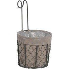 Create a lovely garden oasis with this charming planter, the perfect addition to your yard, porch, or patio.  Product: PlanterConstruction Material: Wire and fabricColor: GrayDimensions: 9.5 H x 4.75 DiameterShipping: This item ships small parcelExpected Arrival Date: Between 05/06/2013 and 05/14/2013Return Policy: This item is final sale and cannot be returned