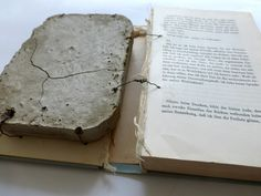 I have no language for my reality. altered book with concrete. Ines Seidel