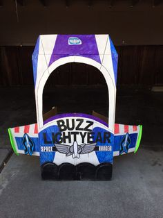 Buzz lightyear photo booth I made for my son's Toy story party. Made out of giant cardboard box found by dumpster, spray painted white, printed a lot of decals, permanent marketed the details. It wasn't too scale but I tried to get it pretty close. Kids loved it, but parents did more:)