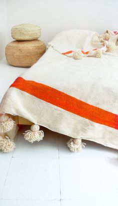 Moroccan POM POM Wool Blanket Ecru and Orange by lacasadecoto