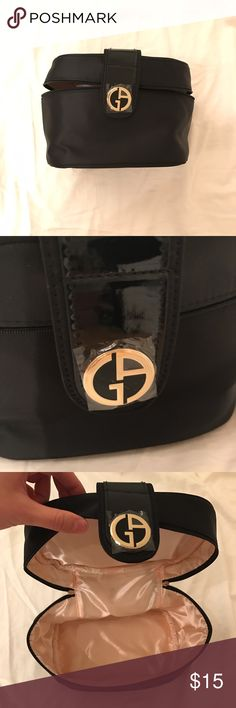 "Giorgio Armani train case ✅ Georgio Armani cosmetic case ✅ new, still has plastic cover on logo  ✅ zips around and has magnetic flap ✅ pretty spacious, about 8"" x 6"" x 6"" ✅ bundle and save! 🚫 no trades Giorgio Armani Bags Cosmetic Bags & Cases"