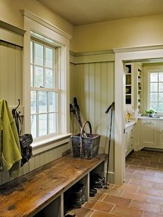 like the deep aged wooden bench with the painted beadboard and like space for boots underneath   Traditional Entry Design, Pictures, Remodel, Decor and Ideas - page 16