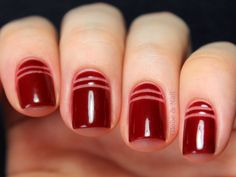 Slim, bare stripes add a sophisticated and modern touch to a rich red manicure, without distracting from the vampy hue. // #NailArt