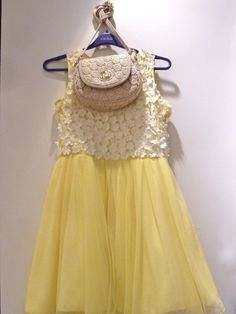 Full length from detail shot, a super lemon tulle skirt mixed with lace for a girls dress at River Island spring 2013