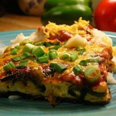 Chili Rellenos Casserole Recipe (I'd replace the canned chili peppers with fresh, diced jalapenos and add scallion onions)