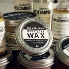 The Mod Cabin's Moustache Wax is an all-natural, medium-firm hold pomade perfect for shaping your moustache or controlling stray beard hair. I scented natural beeswax formula.