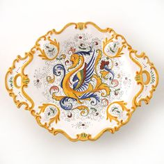 This Raffaellesco platter is the perfect serving platter to compliment any dinnerware. The intricate painting and detail showcase the skill of the artist's hand. $230.00
