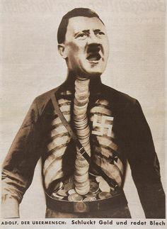 John Heartfield - Adolf, the Superman: Swallows gold and talks tin.    1932 - Anti Hitler Poster
