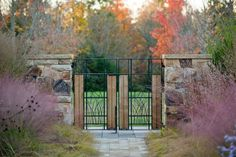 Photograph by Eric Piasecki/OTTO courtesy of Nelson Byrd Woltz Landscape Architects. Planted on either side of a gate, Muhlenbergia capillaris creates a pleasing mirror image. Gardenista
