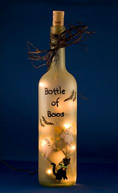 Halloween Bats Lighted Wine Bottle Hand Painted Bottle of Boos Spooky Ghosts Black Cat Night Light Frosted Glass Accent Lamp. $25.00, via Etsy.