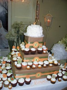 Cupcake tower made from cardboard boxes wrapped in craft paper. We added ribbon and initials cut with the Cricut.