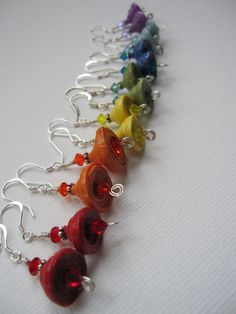Dangle earrings in beautiful rainbow colors made with beads crafted from handmade paper