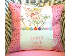 Pink polka dot tooth fairy cushion.  Featuring a sweet little Flower Fairy.  Personalised with your child's name.