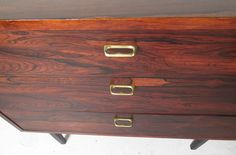 Pair of Mid-Century Modern Rosewood Dressers   From a unique collection of antique and modern dressers at https://www.1stdibs.com/furniture/storage-case-pieces/dressers/