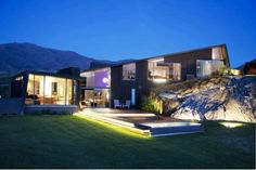 Featuring five bedrooms and four bathrooms, this architecturally-designed home in Queenstown also boasts a state of the art theatre room which is perfect for entertaining and relaxation, and a stunning indoor swimming pool with a diving platform and swimming jet system