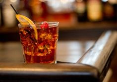 Black Old Fashioned  1 1/2 oz. Black Magic 2 dashes of Peychaud's bitters 1 sugar cube or simple syrup Few dashes of water Ice ball or cubes Garnish with orange slice and a cocktail cherry  A delicious twist on the classic old fashioned.