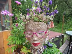 These are so fun to make and very cute in the garden. First you find yourself a styrofoam head that you use for wigs to sit on. I usually pick mine up at garage…