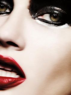 Dark and tempting eye make up with a romantic red lip