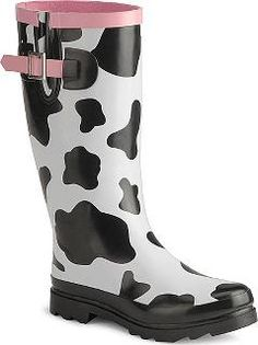 cow print rain boots..oh my geez! I would lovwe whoever left these ...
