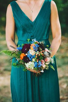 Jewel toned bridesmaids | #Bouquet Design by LaPetiteEvents.com | See More on #SMP: http://www.StyleMePretty.com/pennsylvania-weddings/philadelphia/2016/01/09/enchanting-late-summer-garden-wedding-in-philadelphia/ Photography : LoriGail.com