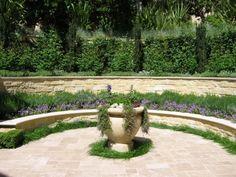 formal courtyard with limestone walls