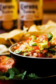 Salsa by mhchipmunk ~ Salsa   5-6 tomatoes  2-3 avocados  1 red onion   2 small limes   1 bunch cilantro   1-2 cloves of garlic   1/2-1 tsp powdered cumin or curry   1. chop the tomato, avocado, onion, cilantro.   2. crush the garlic / squeeze the lime   3. add the spice   4. chill and be sure to cover tightly in a sealed container.
