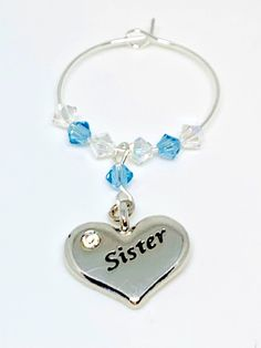 Silver plated heart charm engraved with Sister set with Aquamarine and Clear Swarovski Crystals make this gorgeous wine glass charm Aquamarine is the birthstone colour for March. This gift is perfect with a bottle of bubbly. Swarovski Gifts, Swarovski Crystals, Wine Glass Charms, Personalised Gifts, Aqua Marine, Organza Bags, Heart Charm, Birthstones, Silver Plate