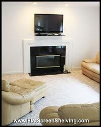 Full-motion TV wall mount installation over apartment fireplace ...