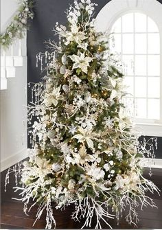 Love the white twigs. You could spray paint twigs for any color/theme tree
