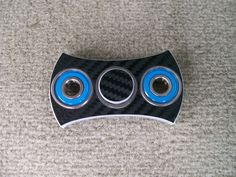 "New from JWraps - ""The Blade"" Fidget Spinner topped with Black Carbon Fiber Wrap - $24.95 plus $3.00 shipping  Crafted from High Density (HDPE) solid marine grade plastic and hand fitted bearings. Designed to last. NOT 3D printed - won't warp or break. Other wrap designs available. In stock, ready to ship! Purchase at our website: ohsnapproducts.com"