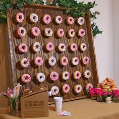 Blogger Sarah Lindner of The House of Sequins easy steps on how to build a DIY donut wall with Dunkin Donuts.