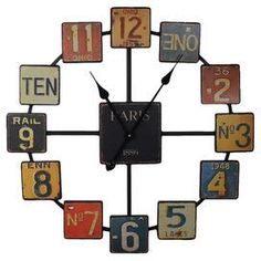 Metal wall clock with multicolored license plate-inspired numbers and an open design. Product: Wall clockConstruction Material: MetalColor: MultiFeatures: Distressed finishAccommodates: Batteries - not includedDimensions: Diameter License Plate Crafts, Old License Plates, License Plate Art, Unusual Clocks, Cool Clocks, Wall Clock Vintage Style, Ideas Paso A Paso, Café Bar, Tabletop Clocks