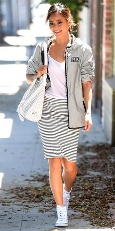 Jamie Chung took on the athleisure trend with a white tee and striped pencil skirt.