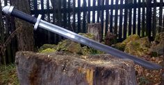 Sharp viking seax with crossguard and pommel.