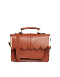 Stash with class. This sun-kissed brown satchel is the perfect way to take this outfit to town.