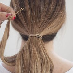 Bobby pin tip: When wrapping hair around your ponytail I like to wrap the ends of the hair around the pin first. It helps it to hold in place!