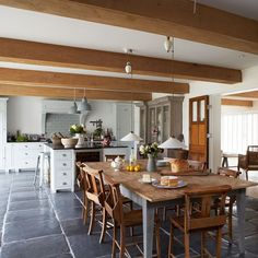 Farmhouse-style kitchen diner with large wooden dining table