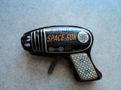 """Atomic Space Gun"" Vintage Tin Toy | Vintage and Retro Space Age Raygun, Rocket and Robot Toys | Sugary.Sweet | #SpaceAge #Toy #RayGun #LaserGun #SciFi"